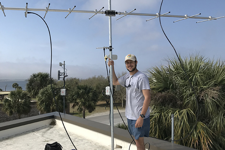 Stewardship Biologist and Technical Coordinator for the project, Matthew King, installing a Motus Wildlife Tracking System at Fort Moultrie in Charleston, SC