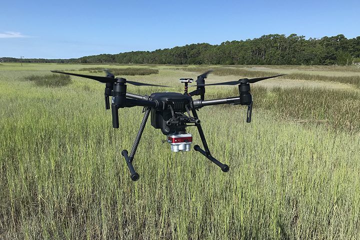 Sensors mounted on drones can provide information that fills important gaps in typical field or satellite-based monitoring programs. (Photo credit: Erik Smith)